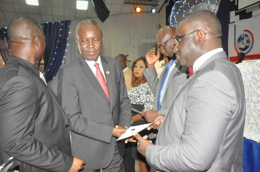 1st Vice President presenting a certificate of membership to a member company
