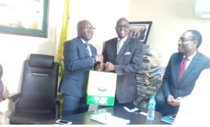 L-R: Executive Chairman, LIRS, Mr Ayodele Subair presenting a gift to Mr. Olusegun Oshinowo, DG, NECA during NECA's courtesy call on the LIRS Chairman.
